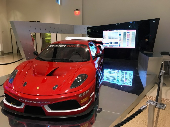 Ferrari parkred on mall floor on display booth for Dream-Racing.