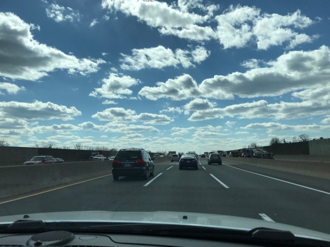 View of New Jersey Turnpike from behind dashboard of Jeep Grand Cherokee.
