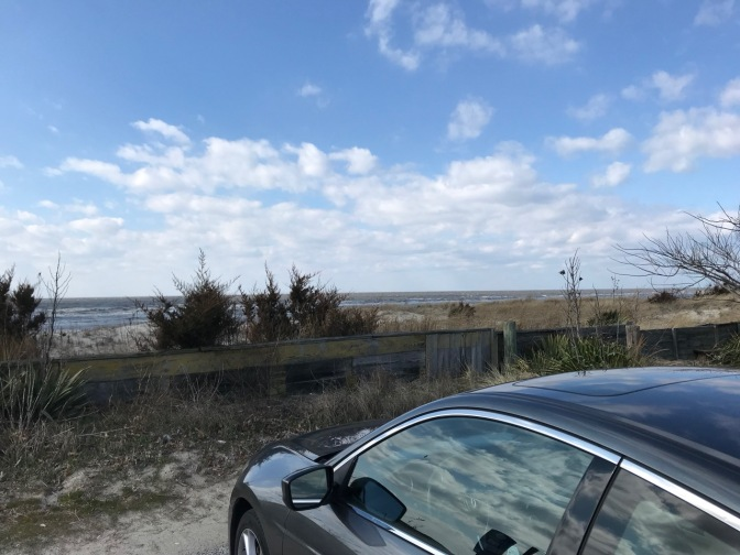 2012 Honda Accord parked by beach, with a wooden fence in the foreground.