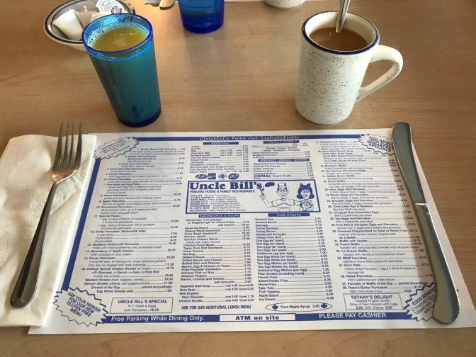 Coffee, orange juice, and placemat menu at Uncle Bill's.