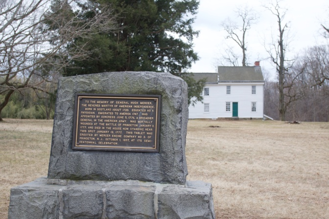 Stone marker indicating where General Hugh Mercer fell. The Clarke House is in the background.