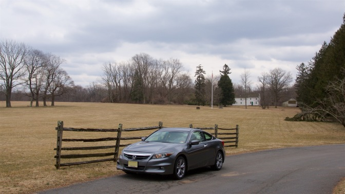 2012 Honda Accord park in front of Princeton Battlefield. A large wooden fence is immediately behind it.