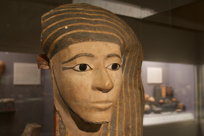 Mummy mask, partially damaged.