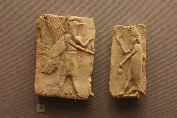 Tile of winged demon (left) and fish man (right).