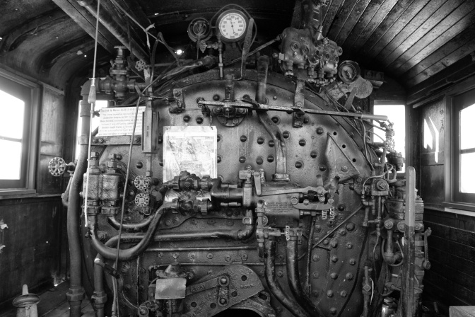 Interior and engine of #1455 steam locomotive.