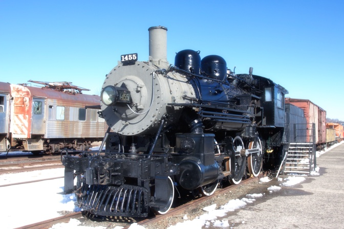 Steam locomotive, in black with a grey nose. The number 1455 is on the nose.