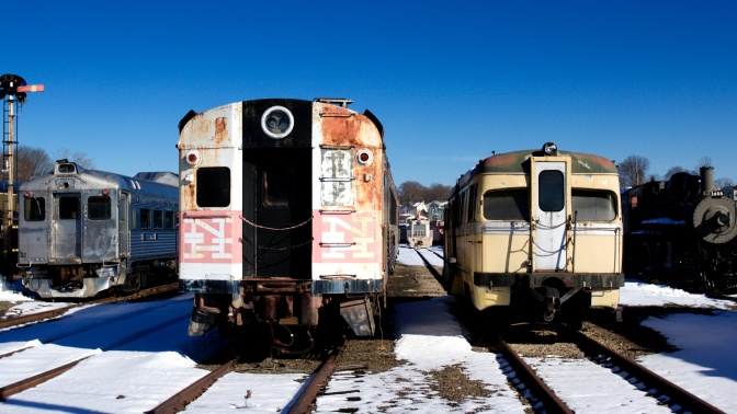 View of four trains in the rail yard.