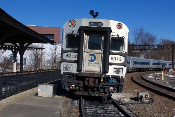 MTA commuter train running beside platform of Danbury Railway Museum.
