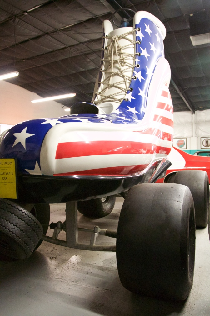 Car built as a roller skate, with red, white, and blue colors.