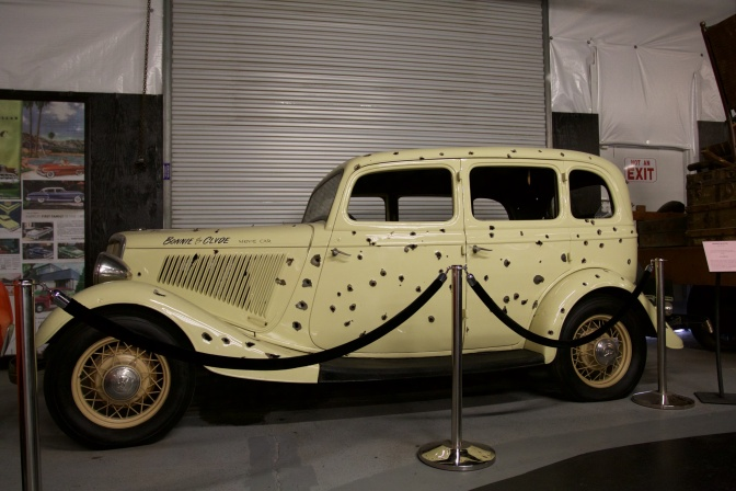 Bonnie and Clyde's Death Car, riddled with bullet holes.