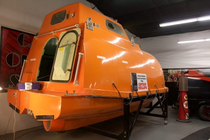 Exterior of orange lifeboat.