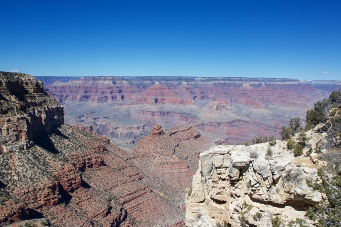 View of the Grand Canyon. Cliffs are in the foreground.