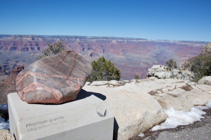 Piece of phantom granite on a pedestal. The canyon is in the background.