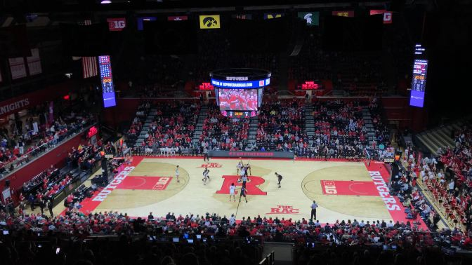 View of Rutgers Athletic Center during a Rutgers-Penn State basketball game. The game is at tip-off.