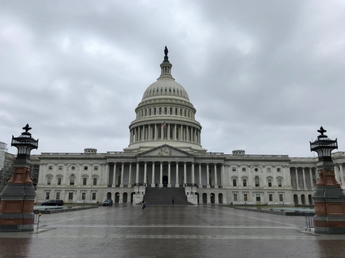 U.S. Capitol, in the rain, with gray skies.