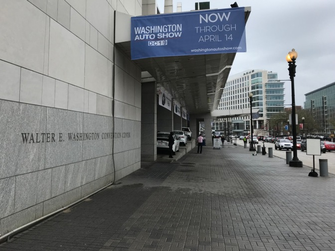 Exterior of Walter E. Washington Convention Center, with a sign saying WASHINGTON AUTO SHOW DC 19 NOW THROUGH APRIL 14