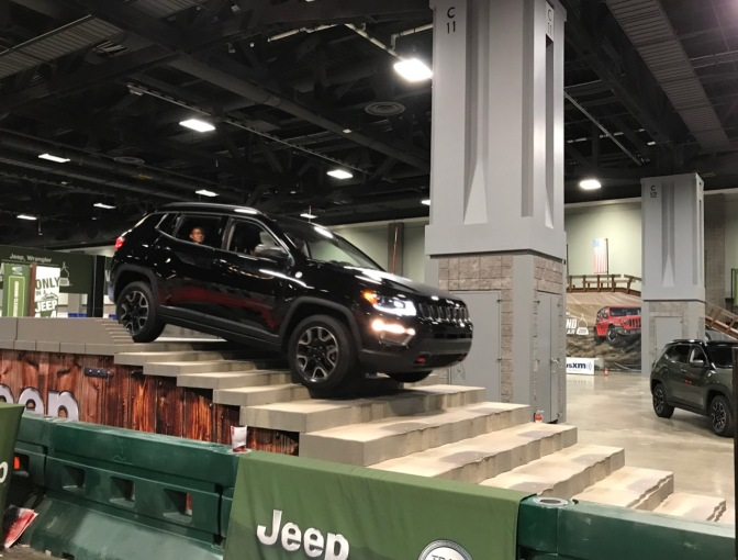 Black Jeep Cherokee descending a staircase.