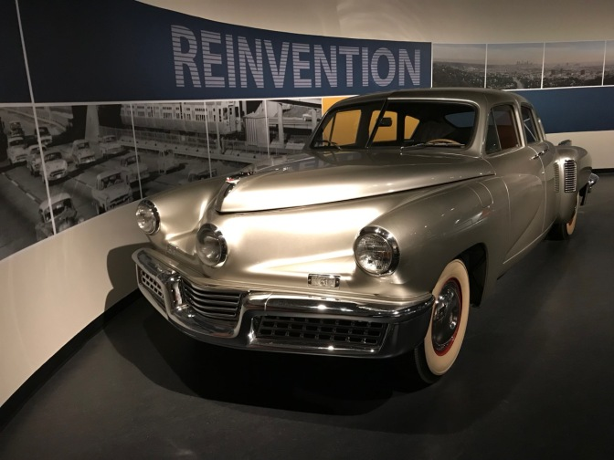 Silver Tucker 48, with a display that says REINVENTION behind it.