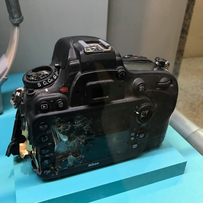 Camera, damaged in the back.