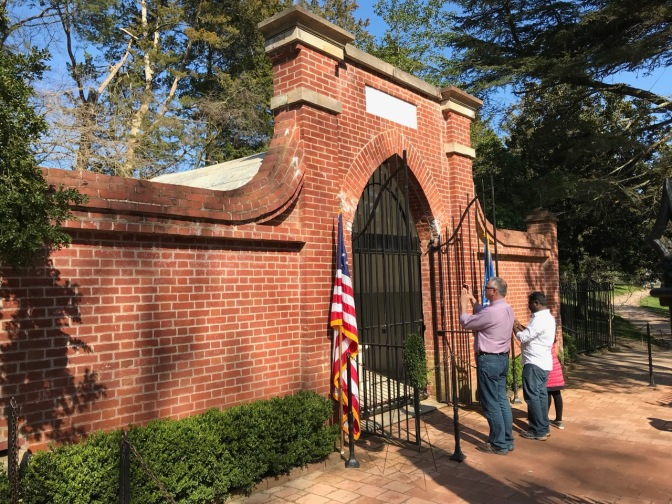 Washington's Tomb, in brick, with iron gates opened in front of it.