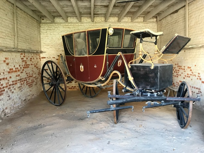 Red coach in carriage house.