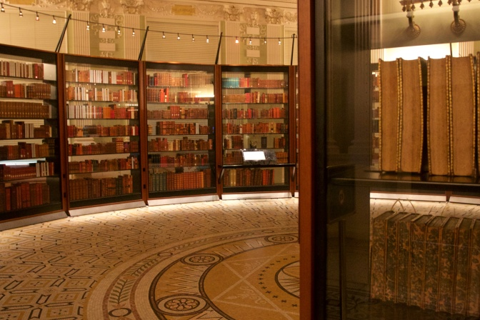 Thomas Jefferson's Library, in a series of circular bookshelves. A tile mosaic is on the floor.