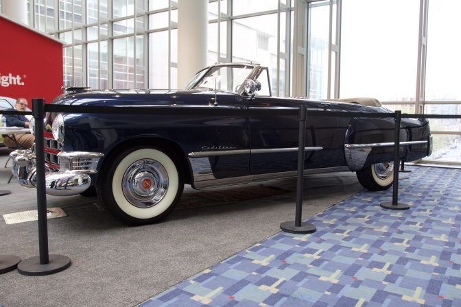 Blue Cadillac convertible.