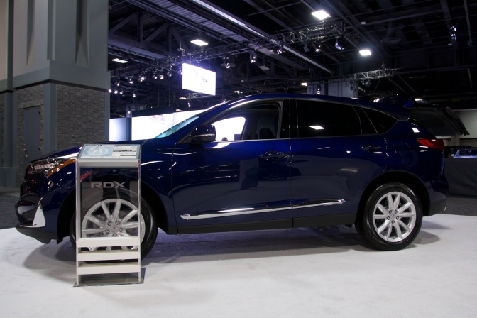Midnight blue Acura RDX on display.
