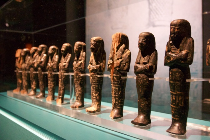 Small statues in a row.