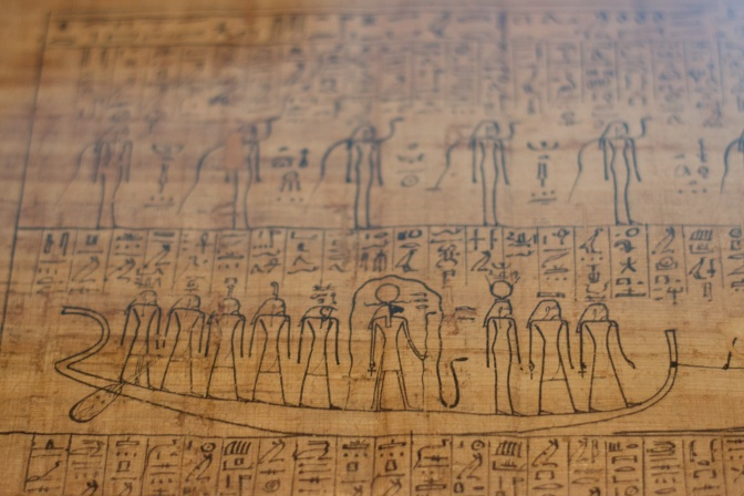 Hieroglyphyics of a boat in the book of the dead.
