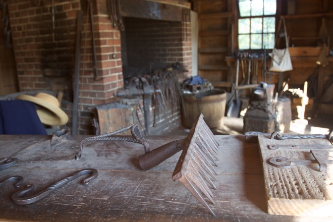 Interior of blacksmith shop, with items made by smiths.