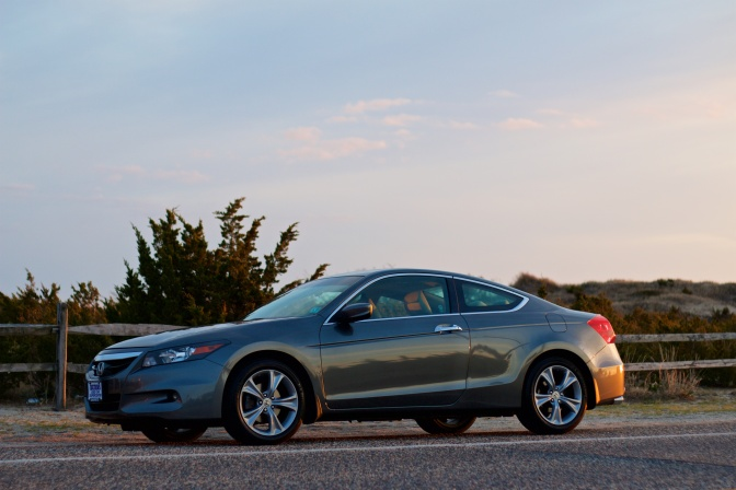 2012 Honda Accord coupe, gray, in front of sand dunes.
