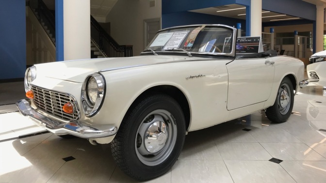 White 1966 Honda S600 roadster.
