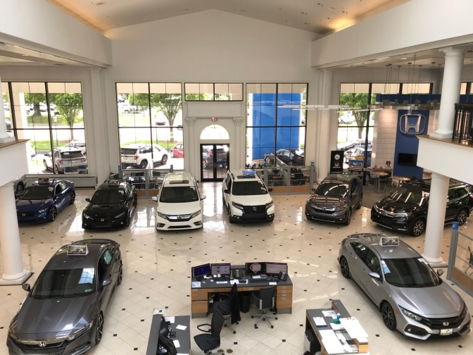 Showroom of Keenan Honda, with various Honda models spread out across the showroom floor.