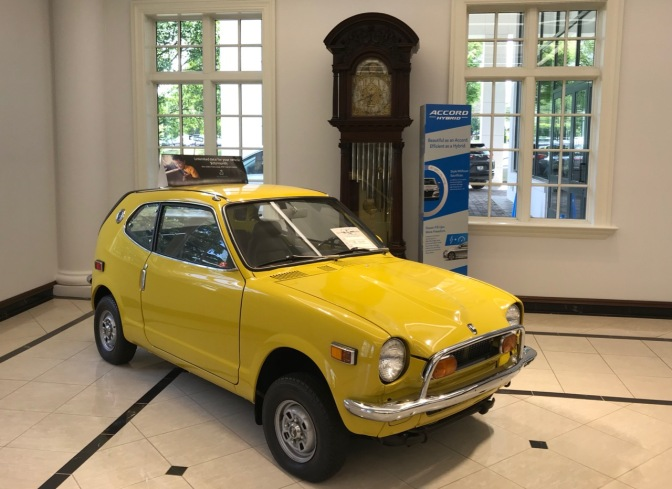 Yellow Honda Z600 coupe.