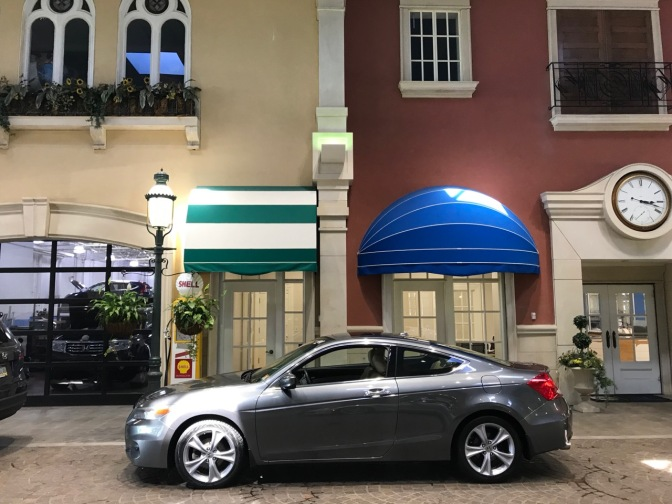 2012 Honda Accord in front of European-style building facade in service drive.