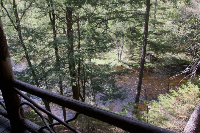 Balcony at back of Wigwam with a view toward stream.