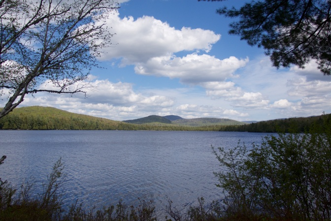 View of Sagamore Lake with mountains in the background.