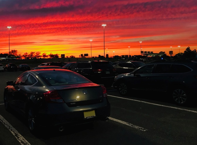 2012 Honda Accord in parking lot beneath sunset sky.