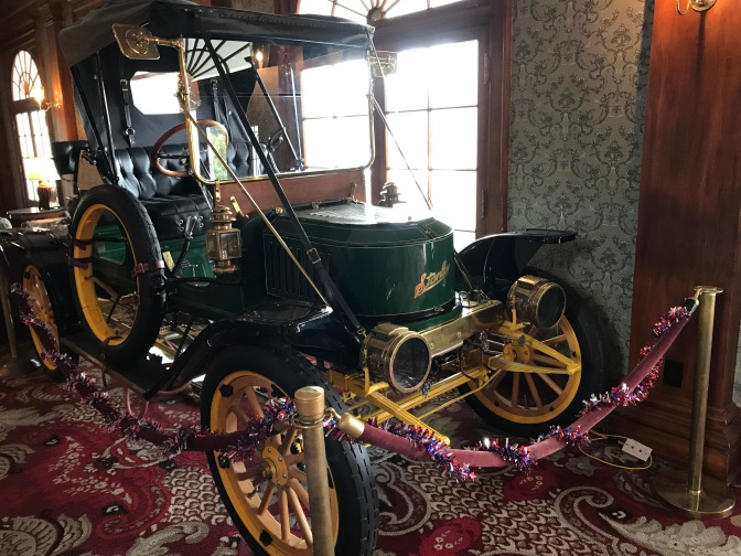Stanley Steamer car in lobby of hotel.