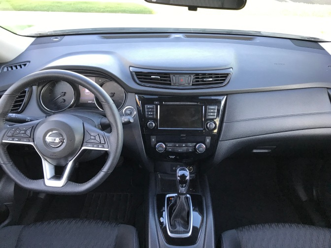 Dashboard and front seats of Nissan Rogue.
