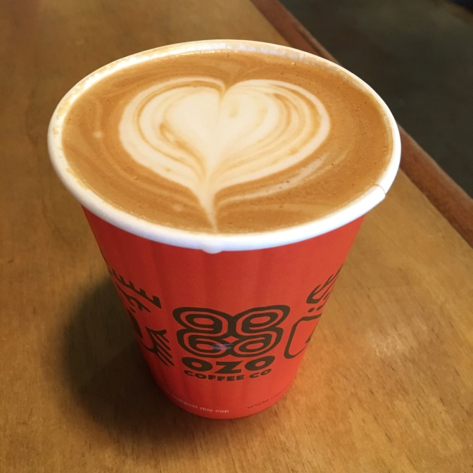 Latte with heart-shaped milk design on top.