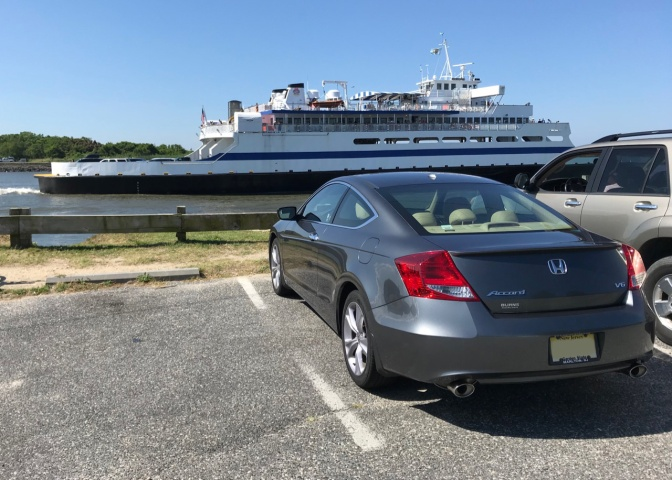 Gray Honda Accord coupe parked, with Cape May Ferry in distance.