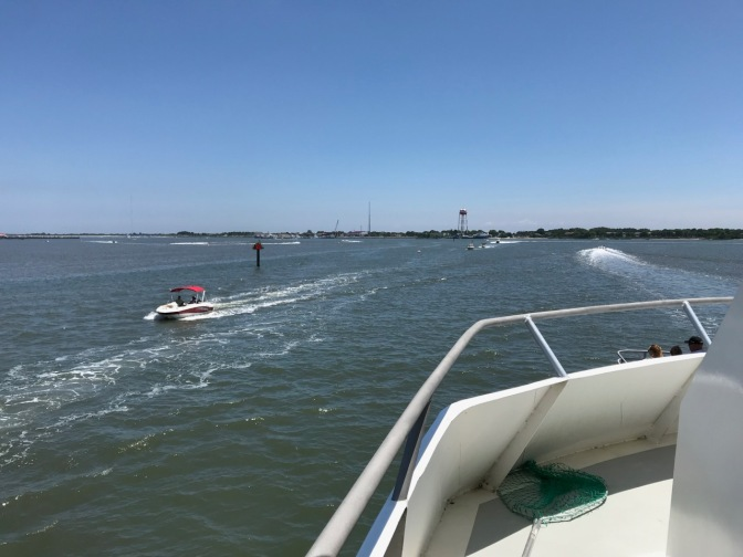 Cape May Harbor, with numerous vessels on the surface.