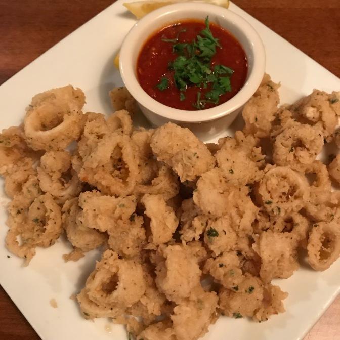 Fried calamari with marinara sauce.