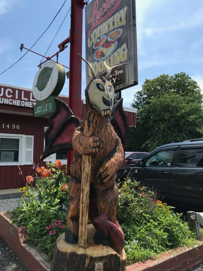 Jersey Devil statue carved from wood outside the restaurant.