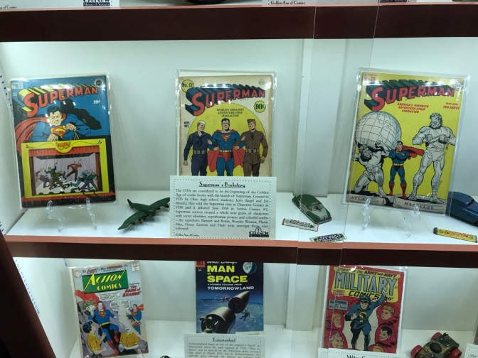 Display of six comic books, including three Superman comic books.
