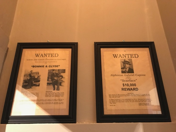 Wanted posters for Bonnie and Clyde and Al Capone.