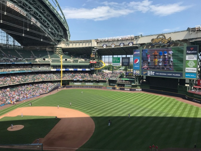Field of Miller Park with Sausage Race displayed on screen.