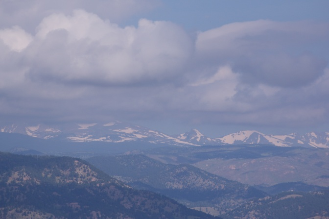 View of Rocky Mountains in the distance beyond the foothills.